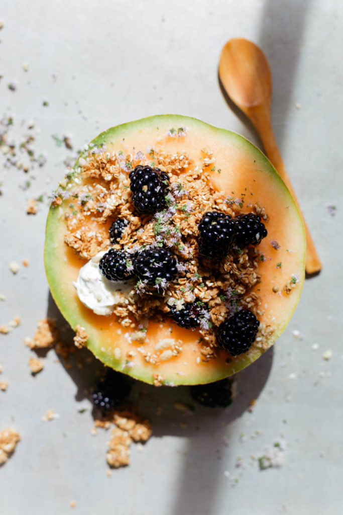 Sesame Coconut Oil Granola Recipe in Cantaloupe Bowls via Yummy Beet