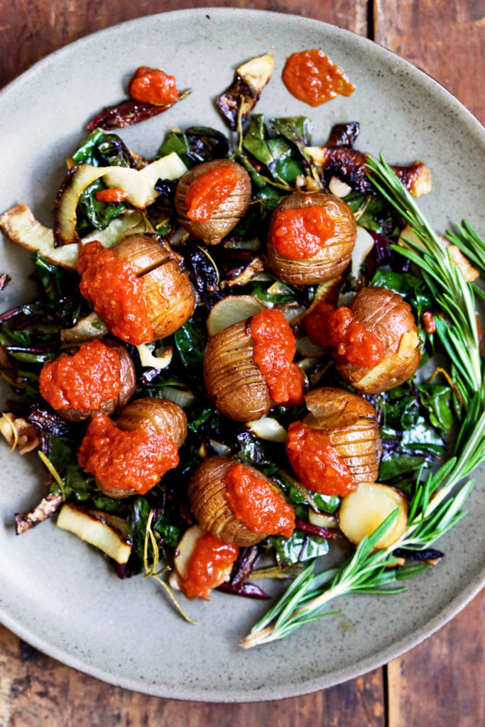 Roasted Hasselback Potatoes & Beet Greens with Tomato Chili Sauce