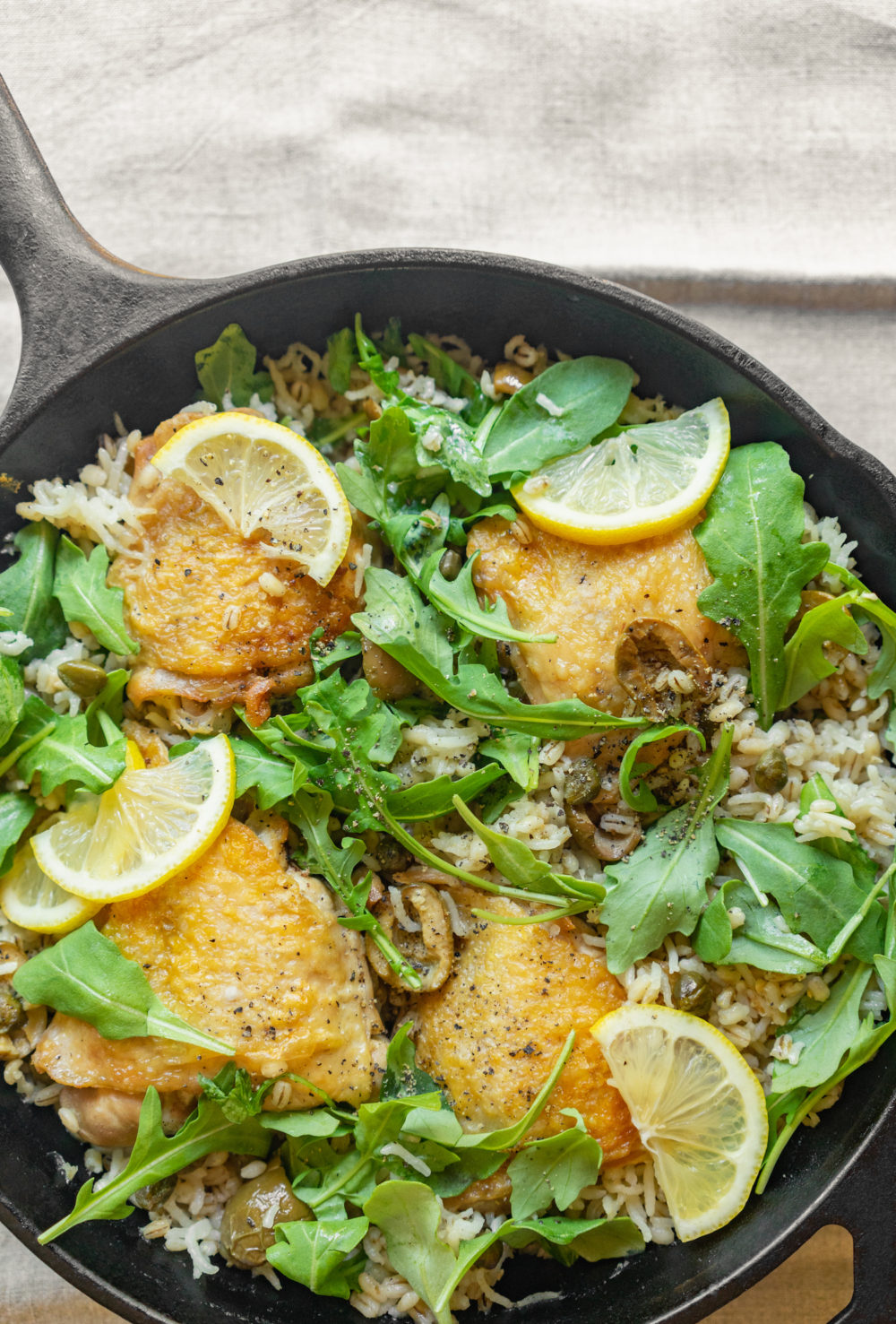 One-Pan Chicken, Rice, & Barley with Capers, Olives, & Arugula